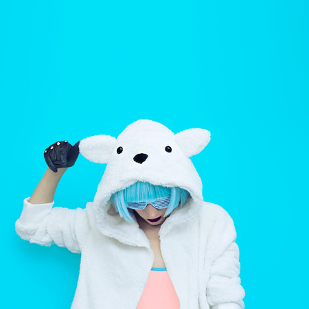 crazy girl: teddy bear girl on a blue background. Crazy winter party. Club dance style Stock Photo