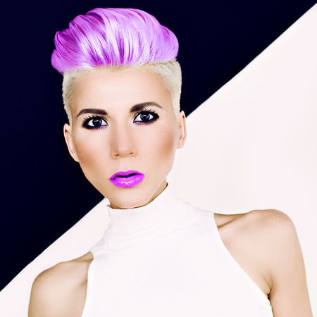 coloured: Sensual portrait blonde girl with fashionable hairstyle and makeup. Colored hair trend