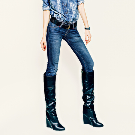 girl boots: Fashionable girl in stylish jeans clothes and boots on a white background