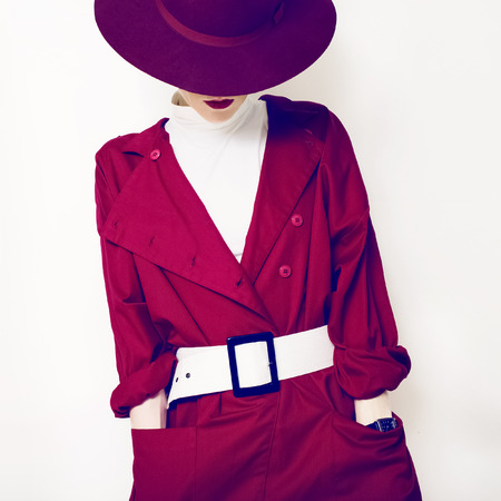 belts: beautiful vintage lady fashionable style in a red cloak and hat Stock Photo