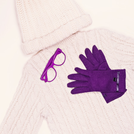 cable stitch: White knit sweater and cap in combination with purple gloves. Winter Fashion Style