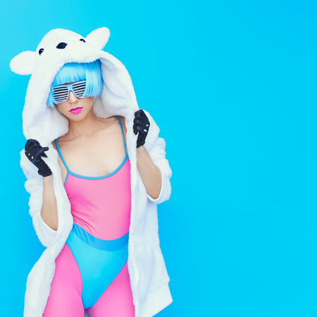 mad: teddy bear girl on a blue background. Crazy winter party. Club dance style Stock Photo