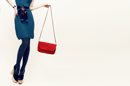 Glamorous lady in vintage trend accessories. Green and red combination in clothing Standard-Bild
