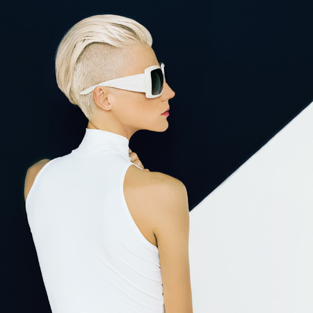 Blonde model in trendy sunglasses with stylish Haircut. Fashion photo Stok Fotoğraf