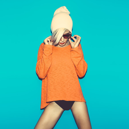 Red panties: Glamorous blonde on bright blue background. fashion party style Stock Photo