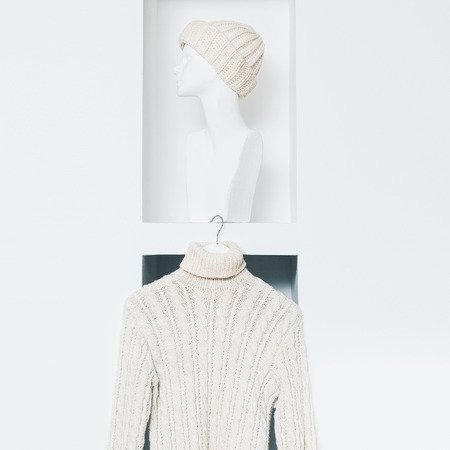 cable stitch: Warm Fashionable Clothing. Trend knit sweater and hat for women