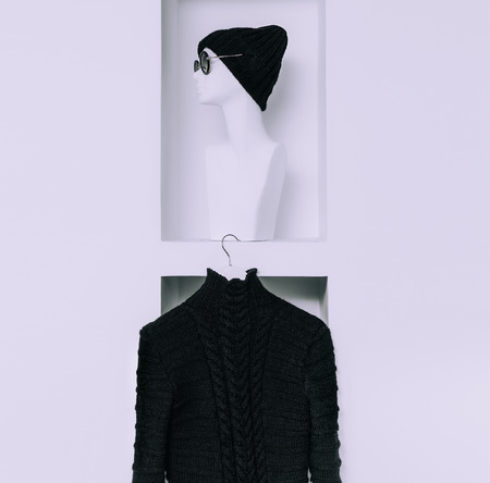 cable stitch: Warm Fashionable Clothing. Trend knit sweater and hat for women. black style