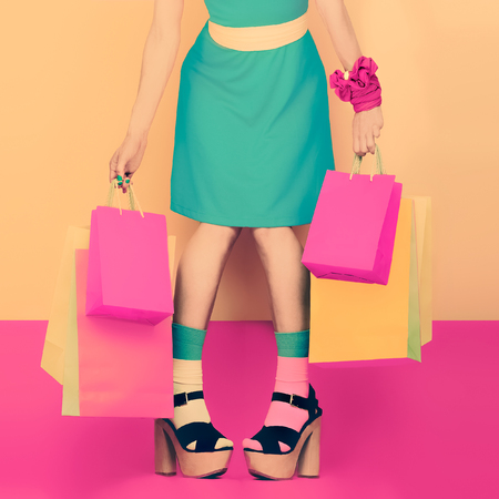 fashion funny lady with shopping. time sales and discounts Foto de archivo