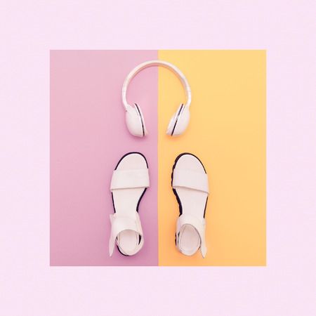 top clothing: Fashion white sandals and headphones on vanilla background. Urban summer time Stock Photo