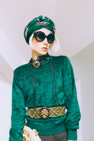Boho style glamorous lady. Spring fashion accessories. Sunglasses, scarf, bag photo