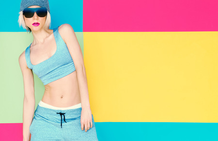 Girl model on bright background. Fashion sports style Banque d'images