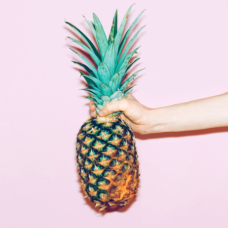pineapple in hand. Fashion minimal design style
