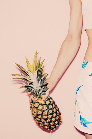 pineapple: Tropical summer. Fashion girl with pineapple. vanilla style Stock Photo