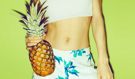 Summer girl with pineapple. Tropical style, fashion, summer clothing.
