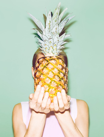 girl holding pineapple. Fashionable stylish summer