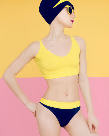 sports wear: Girl in fashionable sport swimsuit and fashion accessories