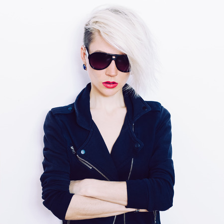 Blonde girl with trendy hairstyle and fashion sunglasses