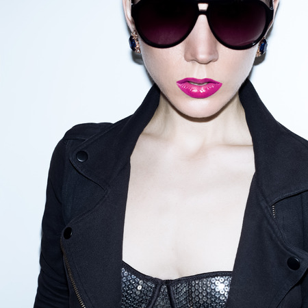 dishevel: Model in fashionable sunglasses. trends the season. Style disco punk