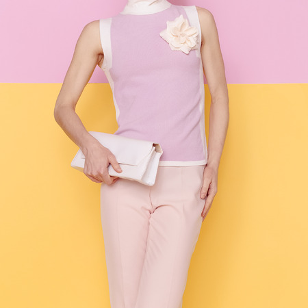 Fashion lady in glamorous summer clothes with stylish accessories. Summer vanilla fresh