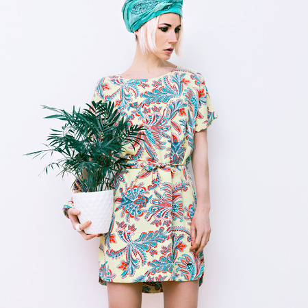 Model with flower in trendy summer dress