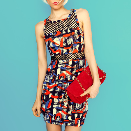 Fashion lady in a fashionable dress and accessories