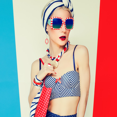 red white and blue: Glamour model in Marine style and polka dots. Beach fashion style Stock Photo