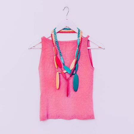 wooden color: Ladies fashion. Wooden beads with bright color shirt. vanilla style Stock Photo