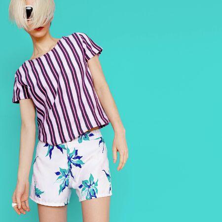 blue shirt: Summer tropical clothing. Fashion lady in beach style