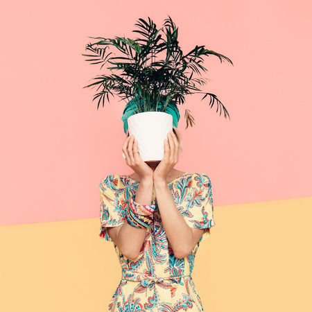 flower pot: Lady hiding her face with flower in trendy summer dress