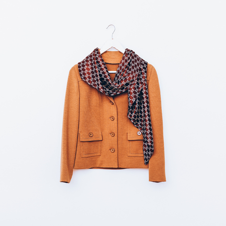 coat hanger: Glamorous vintage. Ladies jacket and scarf. Combination brown shade