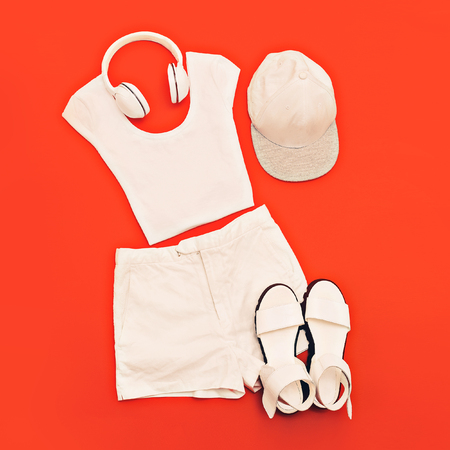 urban style: white set. White clothes and accessories on bright pink background. Urban style