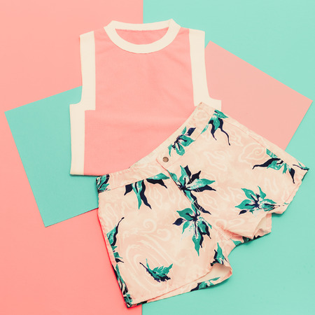 blue background: Lady set. Vanilla summer style. Trendy T-shirt and shorts. Stock Photo