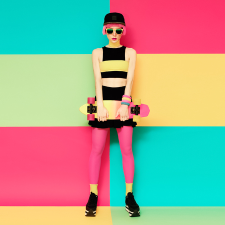 skateboard: Glamour model with skateboard on bright exclusive background