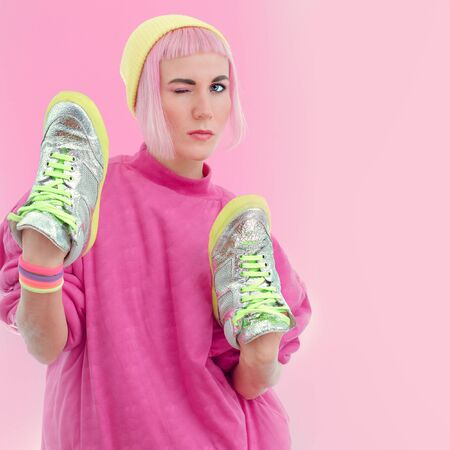 sport clothes: Girl and stylish sneakers. Pastel vanilla style