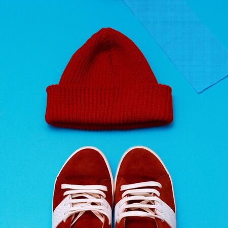 clothes interesting: Stylish urban hipster set. Red sneakers and hat Stock Photo