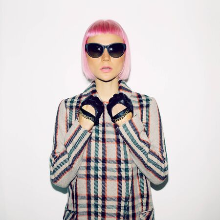glam rock: Fashionable Lady in checkered coat and pink hair