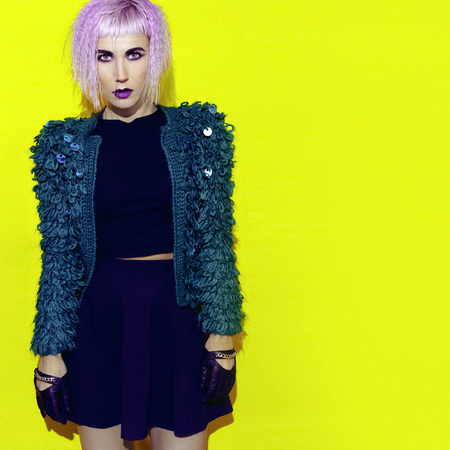 knitted jacket: Blonde in stylish knitted jacket. Party style Stock Photo