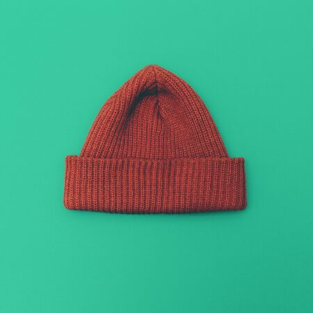 clothes interesting: Stylish hipster cap on green background