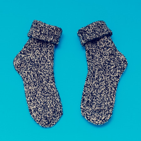 woolen: Warm woolen Socks on blue background Stock Photo