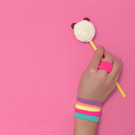 Vanilla color. Lolipop Panda and hand with fashion accessories