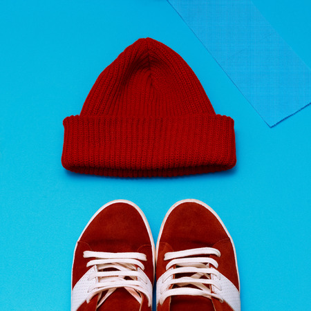 warm cloth: Stylish urban hipster set. Red sneakers and hat Stock Photo