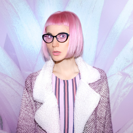 Fashion Lady with fashionable pink haircut