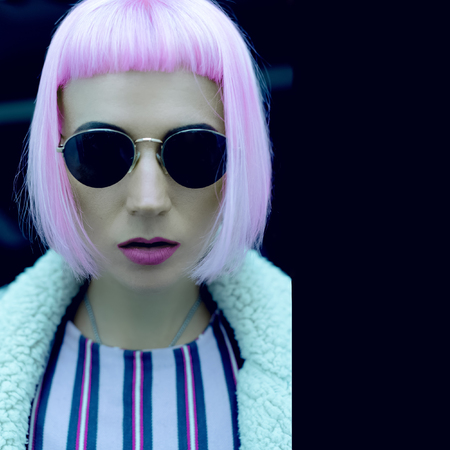 Pop Lady style fashion vintage glasses and pink hair. Stock Photo