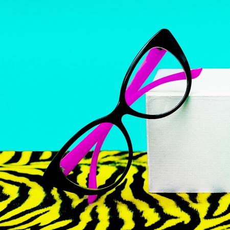 Fashionable Lady glasses on animal style background.