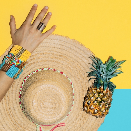 Bright stylish bracelets and straw hat. Time beach holiday. Summer trend. Stock Photo