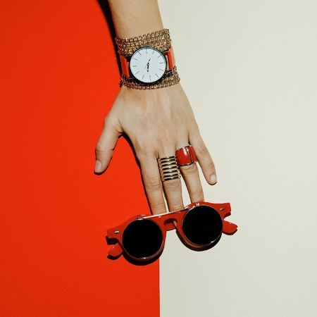 Stylish Accessories. Focus on red. Watches, sunglasses, rings.