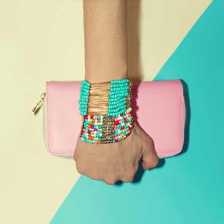 exclusive photo: Ladies accessories. Bracelets and Clutch. Fashion style vanilla.