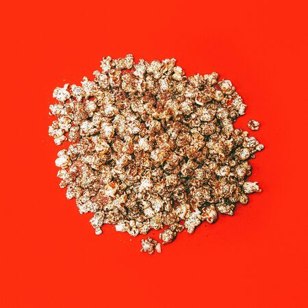 Golden Popcorn on red background. Minimalism style