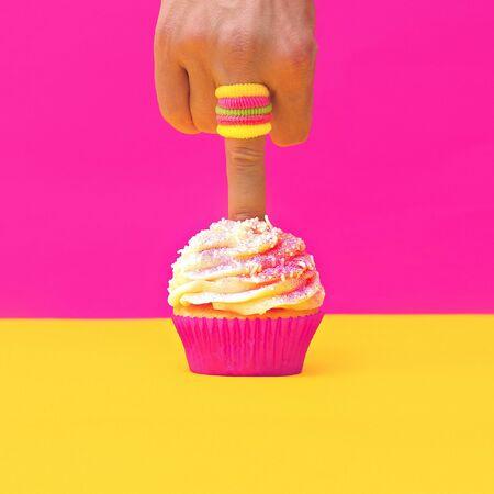 pierce: Finger pokes Vanilla Cake. Minimalism design Stock Photo