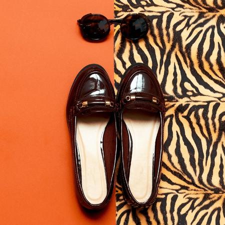moccasins: Autumn Arrives. Stylish Moccasins and Vintage Glasses for Lady. minimal fashion